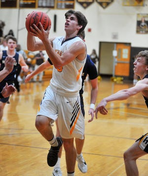 Waynedale's Zach Geiser (5) drives to the rim against Hillsdale. He scored 20 points and reached 1,000 for his career in a 73-53 win.