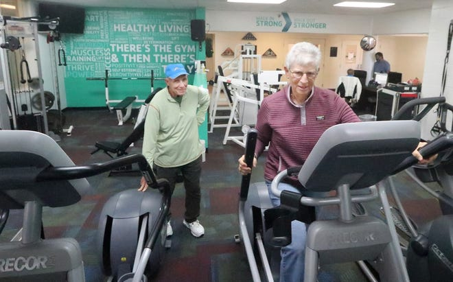 Pictona founders Rainer and Julie Martens check out the workout area at the Holly Hill YMCA recently. The couple have offered to take over management of the Holly Hill facility.
