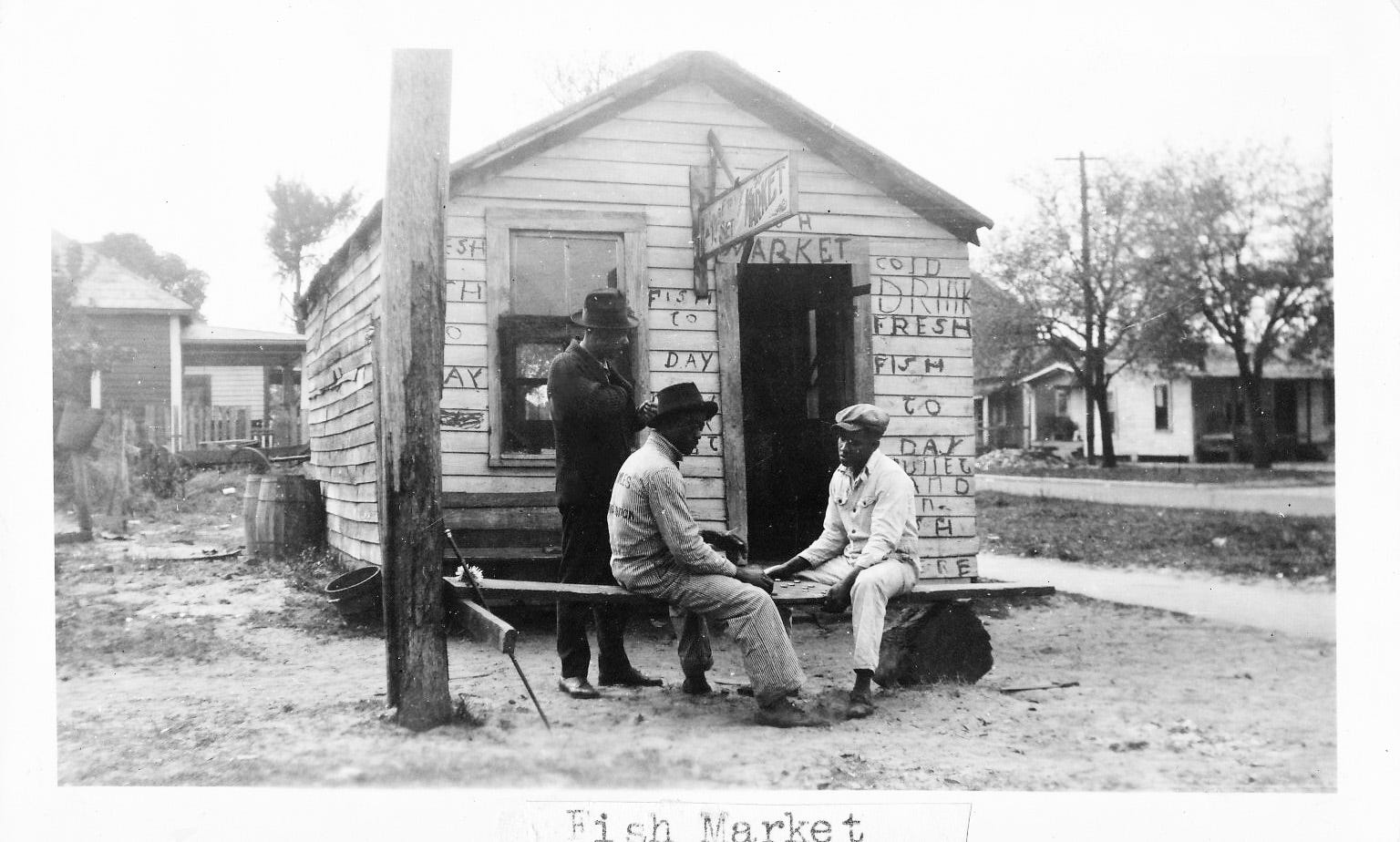 Poverty has always been a part of Daytona Beach's Midtown neighborhood, but residents in the early 1900s made the best of their fate and created a community where people helped one another survive. This scene of two men playing checkers in front of a ramshackle fish market building was shot in 1943.