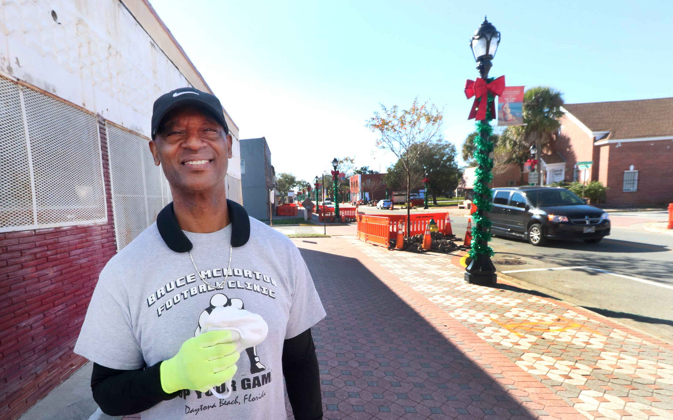 Bruce McNorton is shown standing in front of the building he purchased on Mary McLeod Bethune Boulevard, the old Singleton Cleaners. He plans to use the building for things such as wedding receptions and Sunday afternoon jazz shows. McNorton grew up in Midtown and has returned to Daytona Beach after living in Michigan throughout his nine years playing for the Detroit Lions.