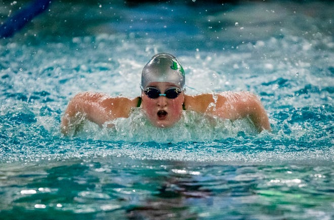 Blue Springs South's Micaela Richards swims to a victory in the 100-yard butterfly in Wednesday's meet against rival Blue Springs. The Jaguars won just five of 12 events but claimed the team win 179-121.