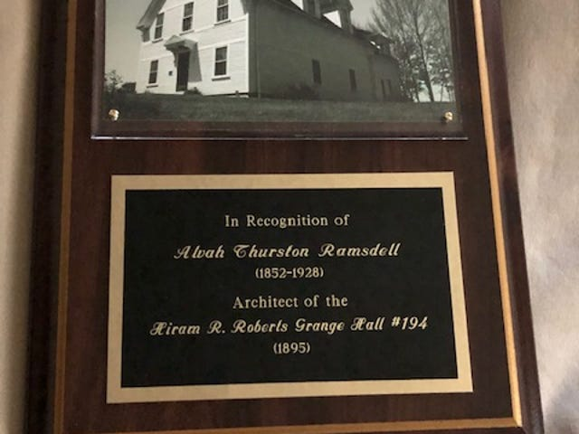 A plaque at the Garrison Players Arts Center in Rollinsford honors Alvah Thurston Ramsdell, the architect who designed the Hiram R. Roberts Grange Hal.