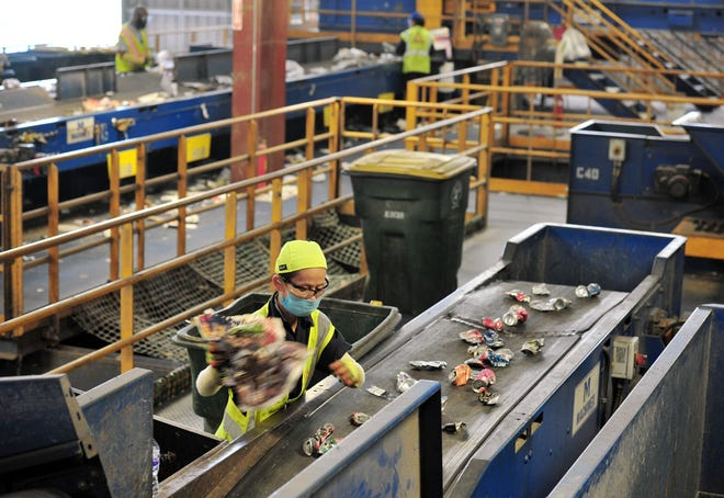 The Republic Services Recycling Center on Imeson Road in Jacksonville is the place where items picked up in curbside bins get sorted. This 2017 file photo shows workers at the fast-moving conveyor belts. About 20 percent of items picked up at the curb aren't actually recyclable and end up in the landfill.