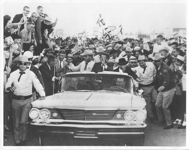 Presidential candidate John F. Kennedy is driven through Wichita in an October 29, 1960 campaign appearance.  Seated to the left of Kennedy is 31-year-old Vern Miller who would gain fame ten years later as the Kansas Attorney General. At the time of this photo, Miller was serving as Marshal of the Court of Common Pleas for Sedgwick County.