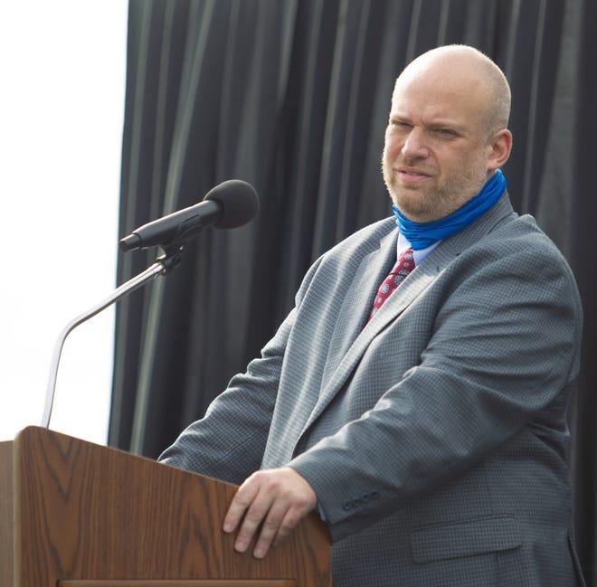 Kirksville High School Principal Christopher Best speaks during the Class of 2020 graduation ceremony at Spainhower Field.