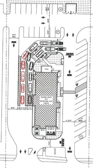 This illustration shows the former Steak-N-Shake property on Route 82 where a Raisin' Cane's chicken fingers restaurant plans to open in spring 2021. A patio is planned in the lower right corner outside the building. The drive-thru lanes and parking spaces also are shown.