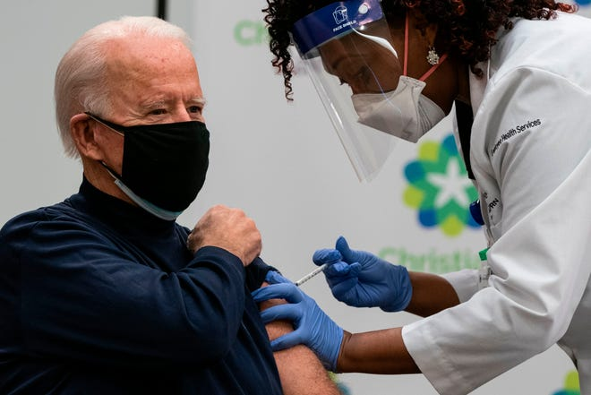 U.S. President-elect Joe Biden receives a COVID-19 vaccination from Tabe Masa, nurse practitioner and head of Employee Health Services, at the Christiana Care campus in Newark, Delaware, on December 21, 2020. (Alex Edelman/AFP via Getty Images/TNS)