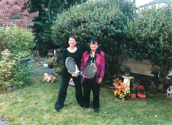 Kathy Martin Holmes, left, and Fay Martin holding tennis rackets;