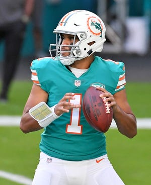 Miami Dolphins quarterback Tua Tagovailoa (1) attempts a pass against the New England Patriots during the first half at Hard Rock Stadium. Credit: Jasen Vinlove-USA TODAY Sports
