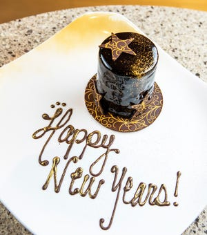 Dessert on New Year's Eve at Restaurant 44 is a hazelnut cake shaped like a top hat and covered in chocolate cremeaux and a crunchy chocolate-and-hazelnut layer.