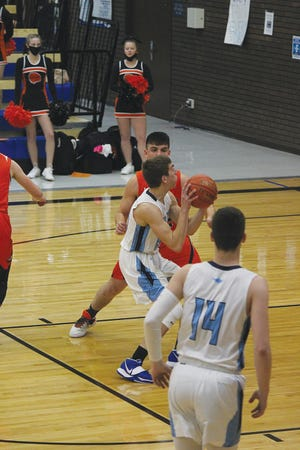 Skyline High School boys basketball team members work for a shot againt Larned on Friday. The T-birds lost  after an early lead, 53-45. They defeated Kinsley earlier in the week.