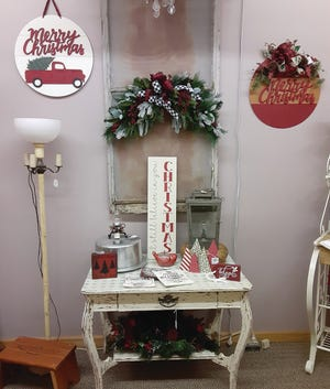 Round Christmas signs (top left) and Skyline step stools from old bleachers (bottom left) are two hot-selling items at Market 54 on Main in Pratt this month. The store is now owned by Karen Hampton.