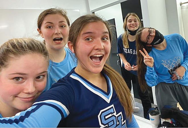 Members of the Skyline High School girls basketball team pose for a selfie while celebrating a win over Kinsley in the first of three games last week.