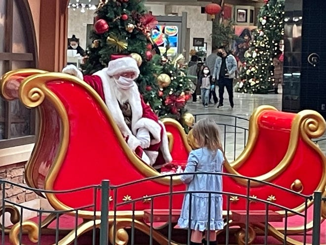 Santa Claus chats with 3-year-old Violet on Thursday at Sherwood Mall in Stockton.