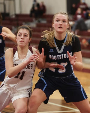 Woodridge senior Bella Owen and Rootstown sophomore Aubrey Kline battle for position under the basket during Wednesday night's game at Woodridge.