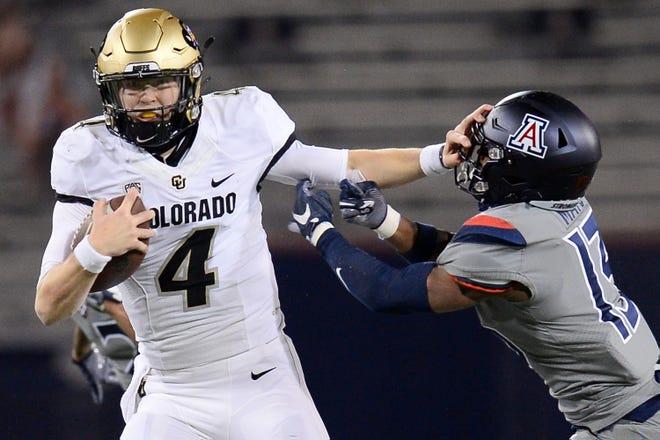Quarterback Sam Noyer (4) leads Colorado against Texas in the Alamo Bowl on Tuesday.