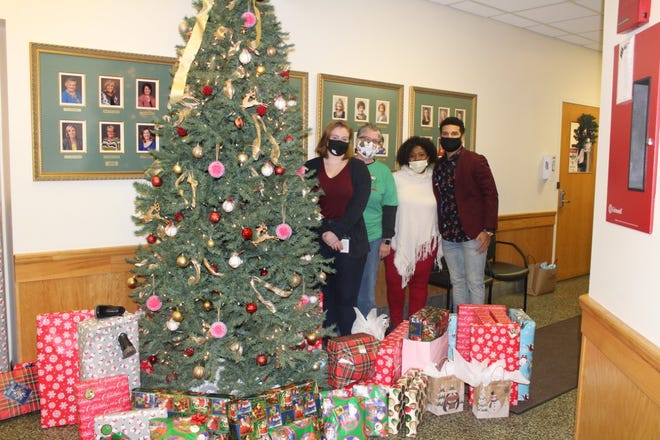 McKinley High School alumnus and West Point cadet Alijah Curtis (right) recently collected and donated more than $2,000 in Christmas gifts for children living at the Canton YWCA family homeless shelter. Pictured with Curtis are (l-r) Megan Wytrzyszczewski, YWCA shelter case manager; Karma Cline, YWCA director of childcare; and Canton YWCA CEO Shana Smith.