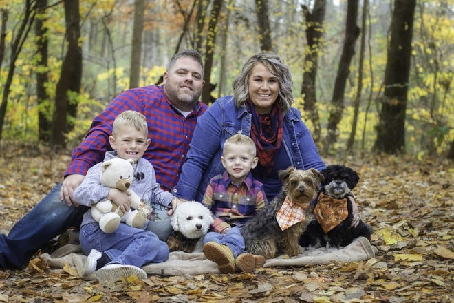 Melanie Bowles, pictured here with husband Bradon, sons Cruz, 6, and Beckham, 3, and dogs Tebow, Zeke and Buddy, dedicates her time to the animal rescue FREEdom Tails Ohio.