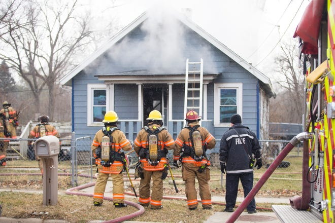 Rockford firefighters work on a residential structure fire at Liberty Drive and Rockwell Street on Thursday, Dec. 24, 2020, in Rockford. The department Tweeted the fire was under control by 2 p.m. and they had rescued one dog from the building.