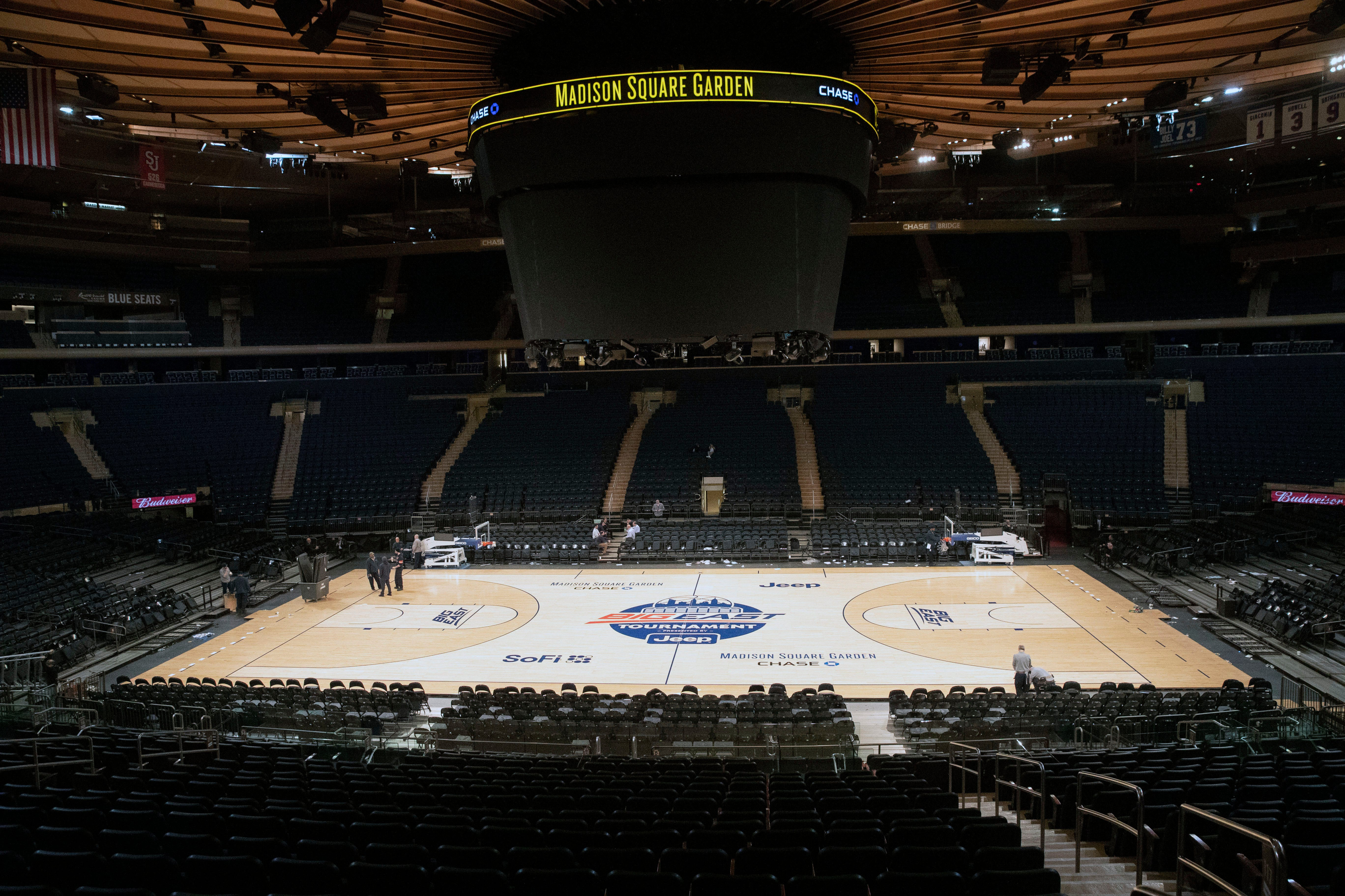 In this March 12, 2020, file photo, Madison Square Garden in New York sits empty after NCAA college basketball games in the men's Big East Conference tournament were canceled due to concerns about the coronavirus.