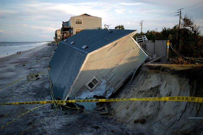 This file photo shows a beachfront house that was destroyed during Hurricane Irma, in Ponte Vedra Beach in September 2017. Insurers in Florida are citing claims for damages in Hurricanes Irma and Michael for property rate increase requests.
