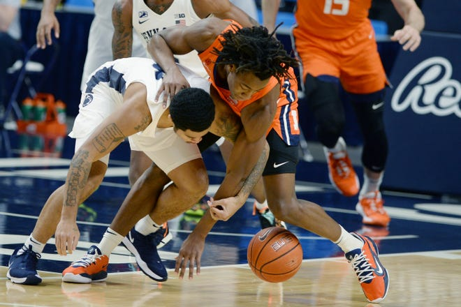 Penn State's Sam Sessoms, left, goes after a loose ball with Illinois' Ayo Dosunmu during first half of an NCAA college basketball game Wednesday, Dec 23, 2020, in State College, Pa. (AP Photo/Gary M. Baranec)