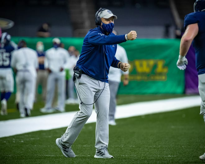 Georgia Southern head coach Chad Lunsford is ready to give a fist bump during the New Orleans Bowl game against Louisiana Tech on Dec. 23, 2020. The Eagles won 38-3.