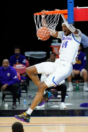 DePaul's Nick Ongenda dunks the ball during the first half of an NCAA college basketball game against Western Illinois, Wednesday, Dec. 23, 2020, in Chicago.