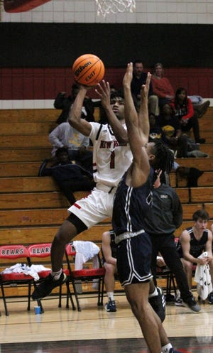 Tyriq Hicks and the New Bern boys basketball team hope to get over .500 this basketball season, which starts in January. Here, he goes to the hoop against D.H. Conley in January 2020.