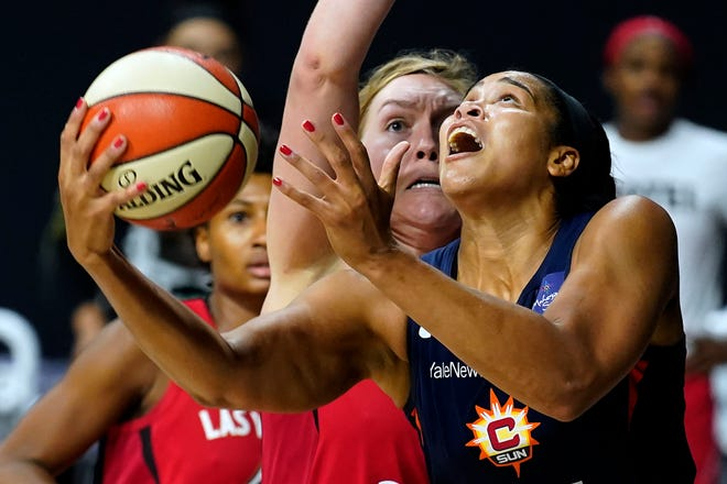 Connecticut Sun center Brionna Jones (42) goes up for a shot while being guarded by Las Vegas Aces forward Angel McCoughtry and center Carolyn Swords during the second half of Game 4 of a WNBA basketball semifinal round playoff series Sunday, Sept. 27, 2020, in Bradenton, Fla.
