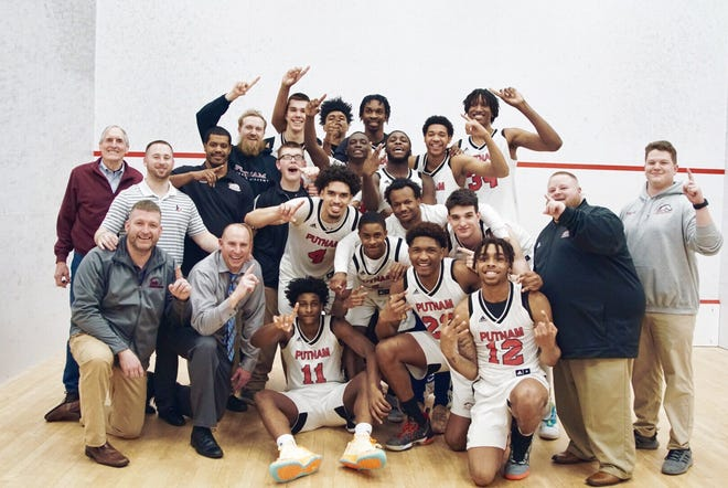 Members of the Putnam Science Academy prep basketball team celebrate after winning the co-national title on March 12.