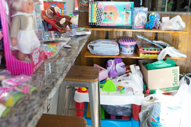 Toys to be donated to the Topeka Rescue Mission fill the front of Topeka Pizza, 1630 S.W. Arvonia Place, last week. The traditional Christmas Shop for TRM was replaced with a drive-thru service for families in need.