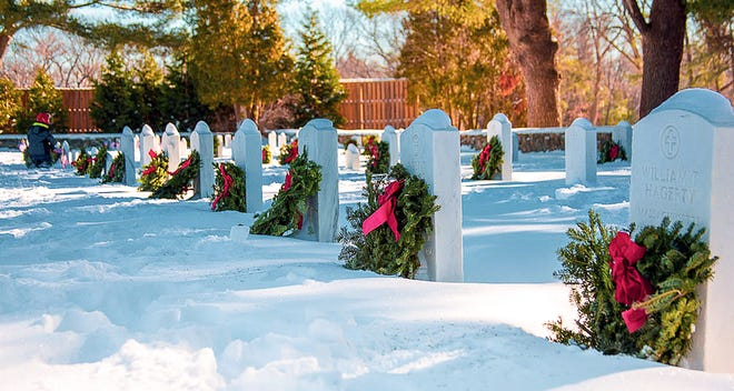 Wreaths decorate graves at Fort Devens for Wreaths Across America.