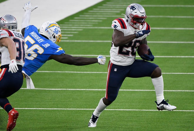 Patriots running back Sony Michel (26) breaks away from Chargers outside linebacker Kenneth Murray earlier this month.