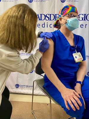 Jessica Pitcock, director of the Medical Intensive Care Unit at Gadsden Regional Medical Center, was the first GRMC staff member to receive the COVID-19 vaccine. COVID positive patients at GRMC currently are housed in the MICU.