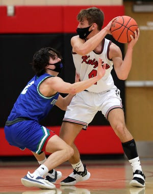 Lourdes Academy basketball standout Preston Ruedinger, right, recently went over 2,000 career points.
