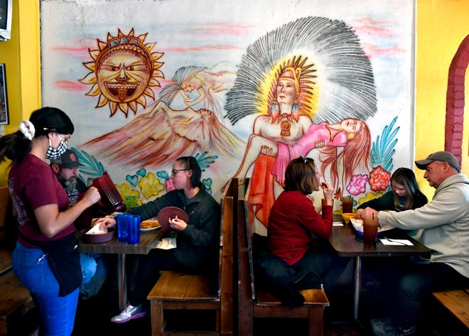 Customers dine during lunch at El Fenix Cafe on Thursday. It was the final day of business for the longtime Abilene restaurant.