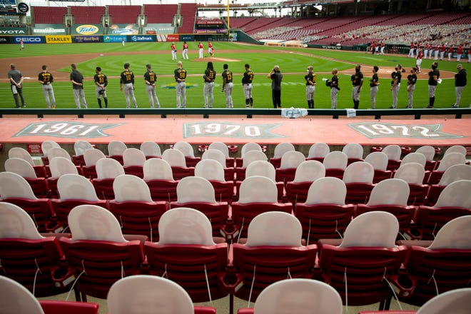 Cardboard cutouts of fans lined the seats down the third-base line last season at Great American Ball Park. This season, there will be  12,696 fans a game, at least at the start.
