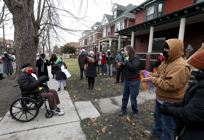 Wes Nethercott of Detroit greets and talks with neighbors from the Hubbard Farms community in Detroit on Thursday, Dec. 24, 2020.