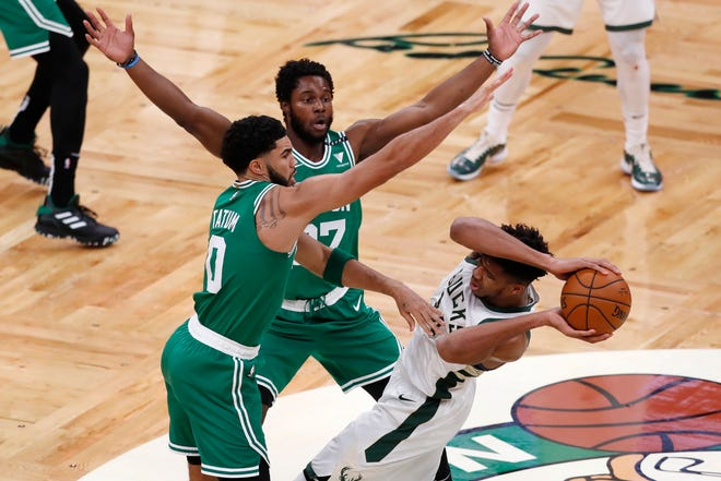 Semi Ojeleye, top, is known mostly for being a defensive player. He is signing with the Milwaukee Bucks after four seasons with the Boston Celtics.