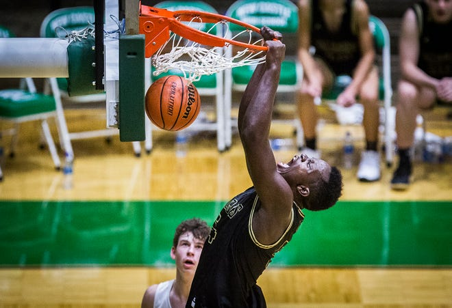 During a game while playing for Winchester, Payton Sparks dunks against New Castle at New Castle High School on Dec. 23, 2020.