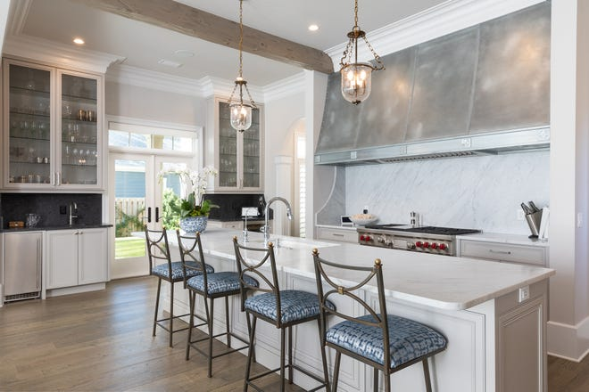 The kitchen includes a fabulous gas range and bar seating.