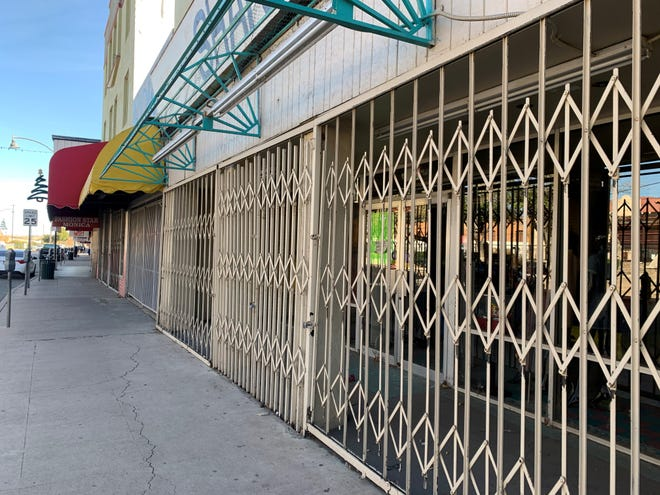 The majority of stores along the Morley Avenue shopping district in downtown Nogales remain shut down because of the impacts of the COVID-19 pandemic. The stores would normally be packed with holiday shoppers this time of the year.