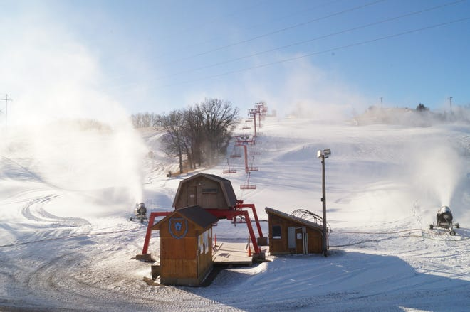 Snow machines blowing fake snow on the hill at Great Bear Ski Valley on Dec. 24