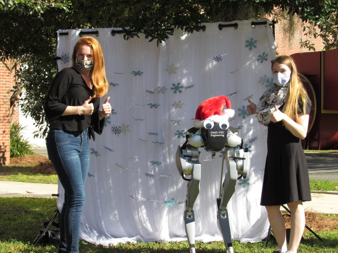 Elle, an undergraduate with the FSU Penguineering team, and Stacy Ashlyn, created a fun safe way for families to celebrate the holidays with the Santa robot.