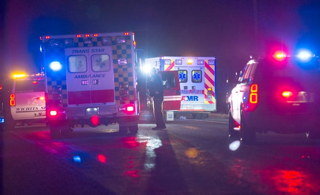 Emergency medics worked to transport a victim from the scene of an accident to the hospital Wednesdy night.