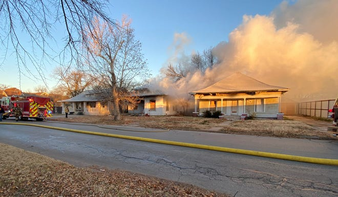 Wichita Falls Firefighters worked to control a two-alarm structure fire Thursday at a house in the 2000 block of Tenth Street.