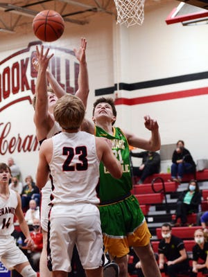 Newark Catholic's Matthew Gialdini fights for a rebound with Crooksville's Brayden Cavinee, left, and Caden Sparks during the Green Wave's 66-61 win on Wednesday night in McLuney. Gialdini scored 18 points, including seven in the fourth quarter.