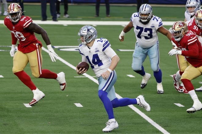 Dallas Cowboys quarterback Andy Dalton escapes for yardage as San Francisco 49ers defensive tackle Javon Kinlaw, left, and Kerry Hyder Jr.give chase during the Cowboys' 41-33 win Sunday. Dalton is now 3-4 as a starter after taking over for an injured Dak Prescott.