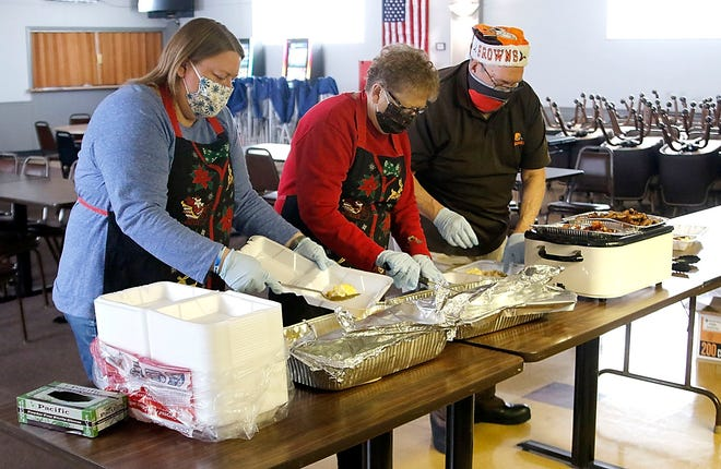 Denise, Donna and Dave Swartz pack up some of the take out breakfasts being served by the Elks on Christmas Day Friday, Dec. 25, 2020. TOM E. PUSKAR/TIMES-GAZETTE.COM